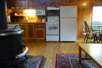 Artist Cottage Kitchen & Living Area with Wood Stove